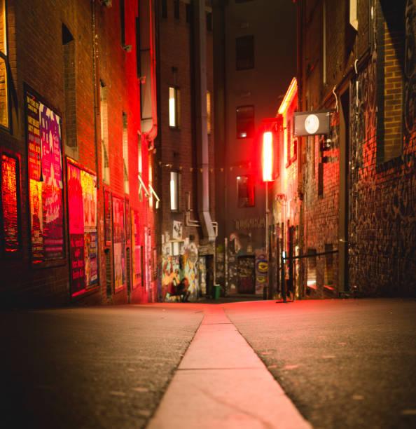 Looking down a laneway at night along Flinders lane. stock photo