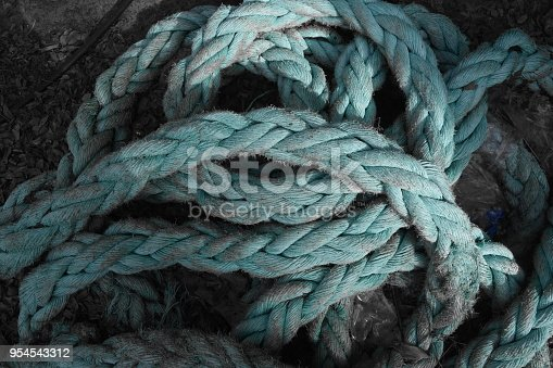 Looking down at a turquoise rope