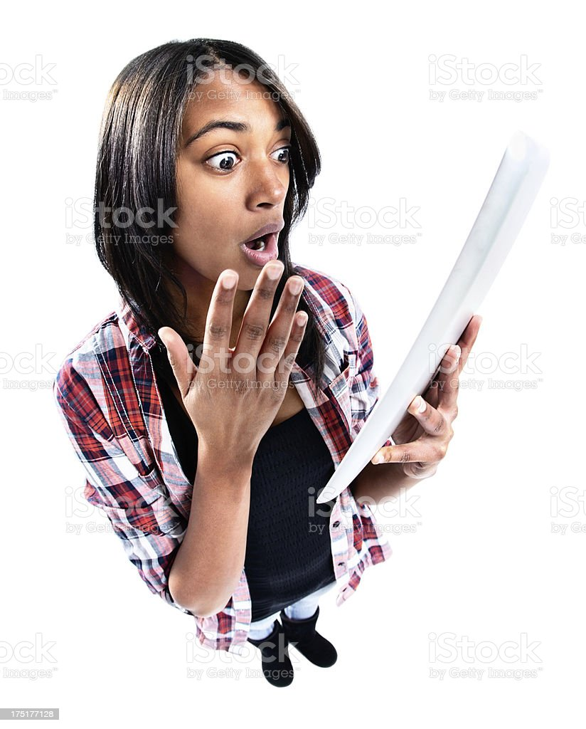 Looking down at cute teenager shocked by digital tablet image royalty-free stock photo