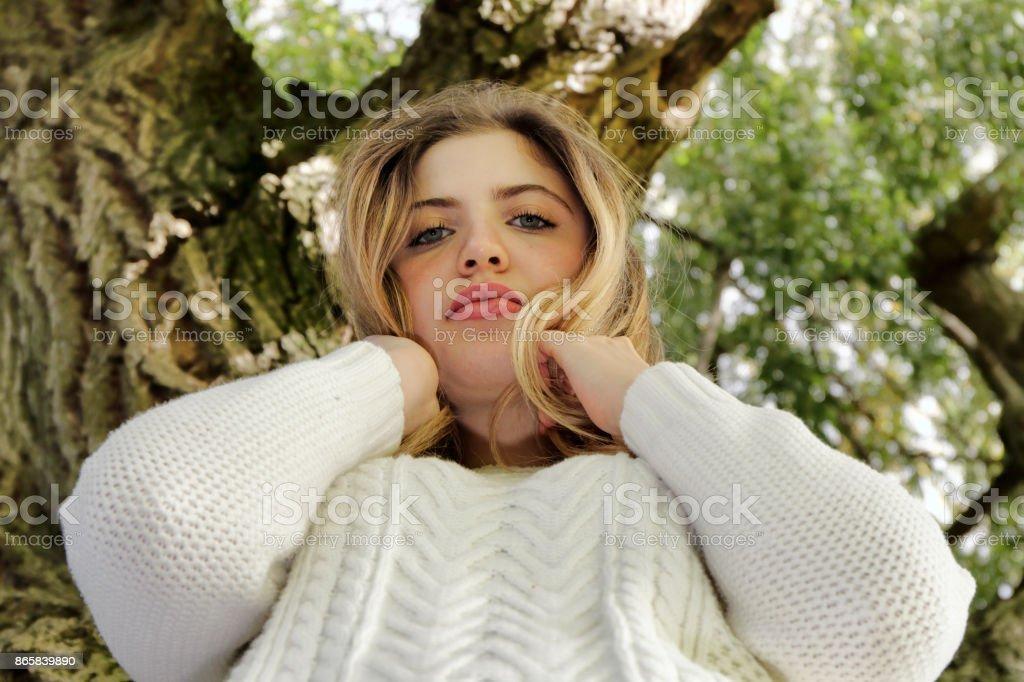 Looking down beautiful blonde Bulgarian outdoor girl stock photo