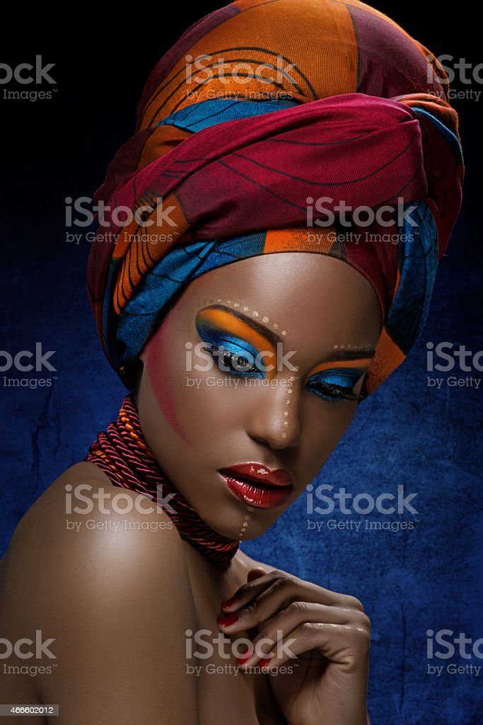 Looking down black woman with bright colourful makeup for African photoshoot ideas