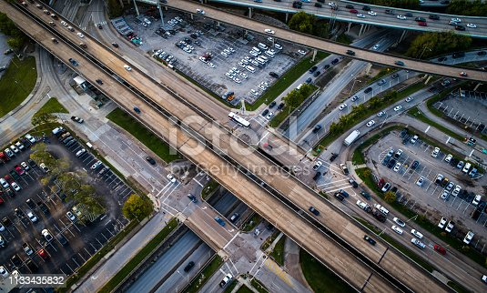94502198istockphoto Looking down from above highways and parking lots transportation infrastructure 1133435832