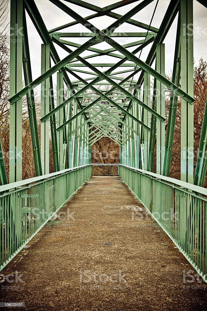 Looking Down Old Metal Footbridge From End of Bridge royalty-free stock photo