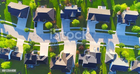 istock Looking down on beautiful suburban homes, Springtime aerial view. 691254458