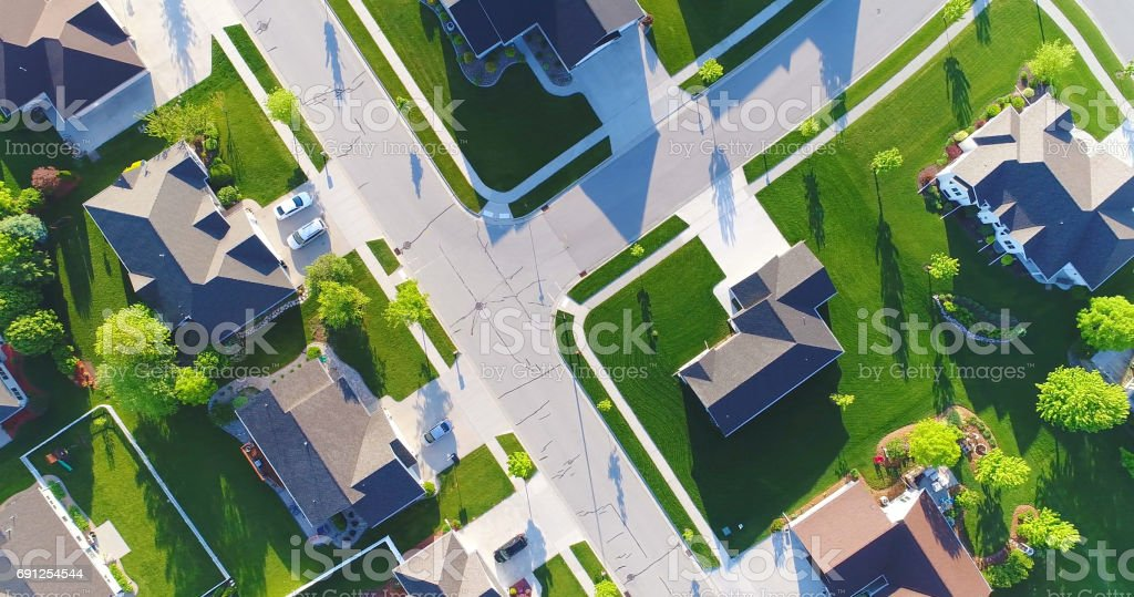 Looking down on beautiful suburban homes, Springtime aerial view. stock photo