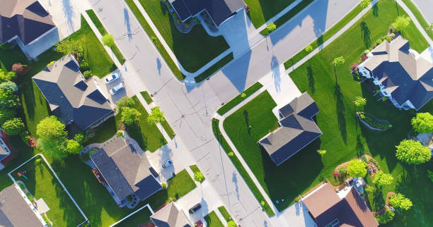 looking down on beautiful suburban homes, springtime aerial view. - district stock pictures, royalty-free photos & images