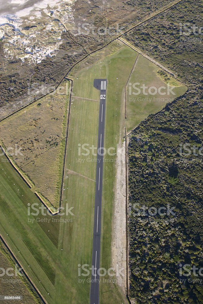Looking down on coastal airfield royalty-free stock photo
