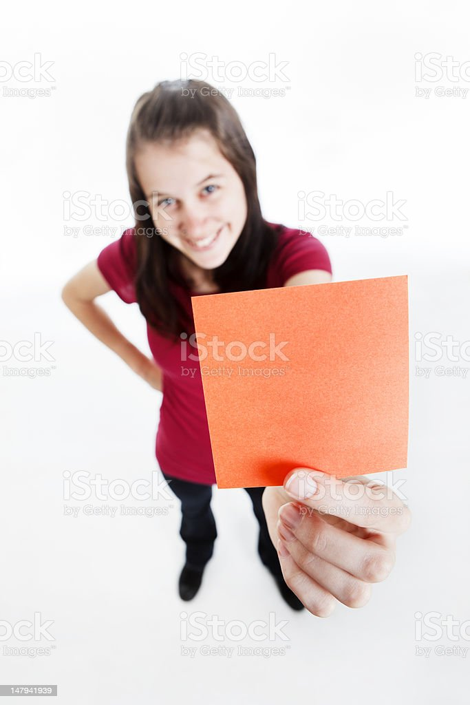 Looking down on cute girl holding up blank message royalty-free stock photo