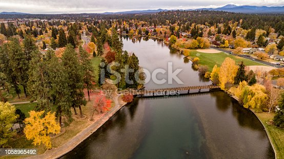 Looking down on Deschutes River in Bend Oregon lined with autumn colored trees