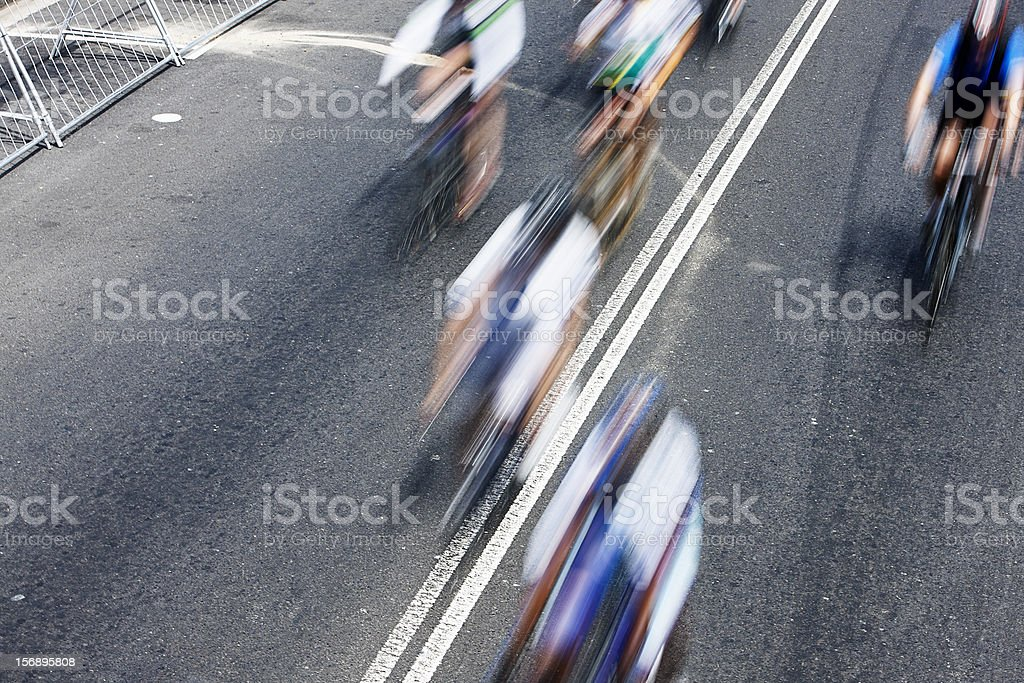 Looking down on motion-blurred racing cyclists royalty-free stock photo
