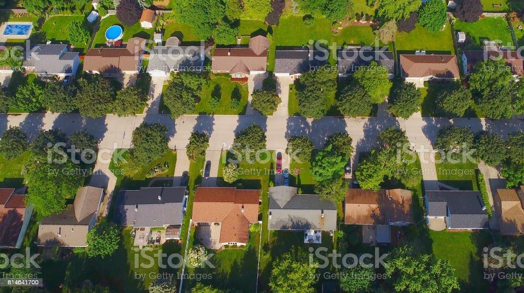Looking down on nice neighborhoods on sunny Summer morning stock photo