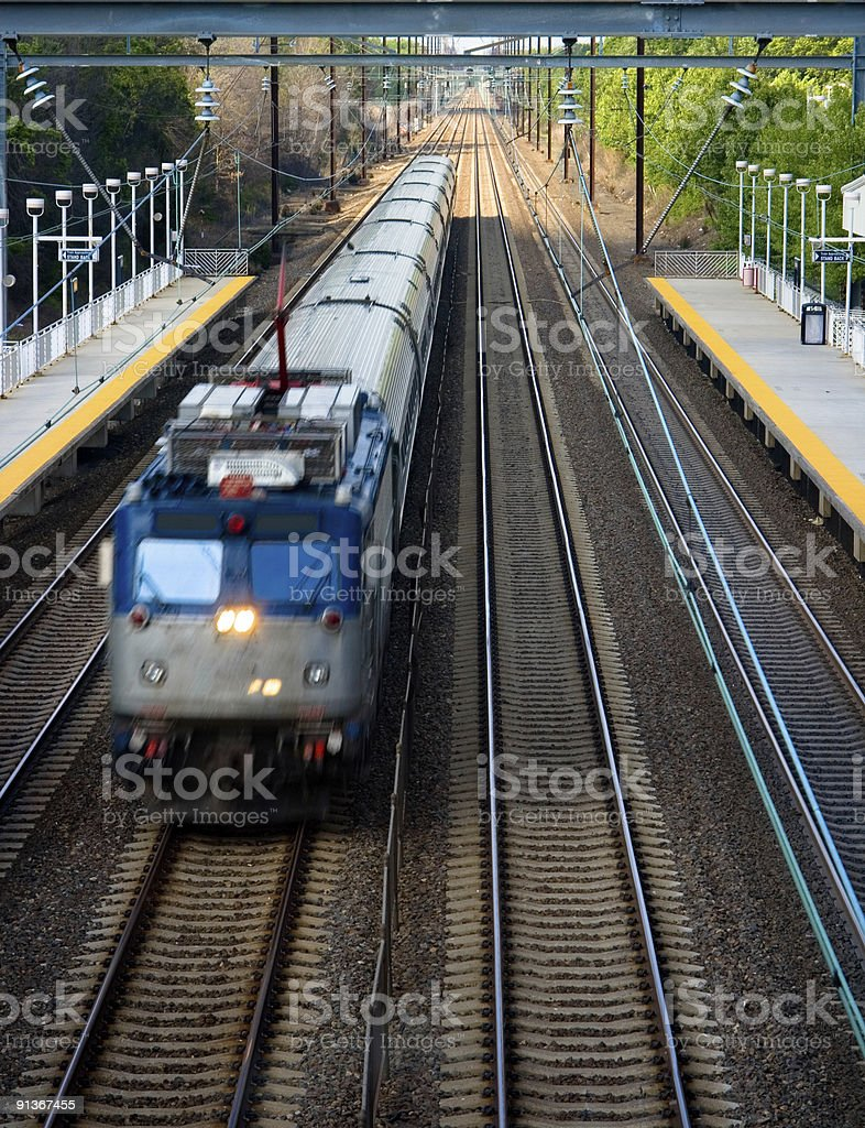 Looking Down on Passenger Commuter Train Passing Through Station stock photo