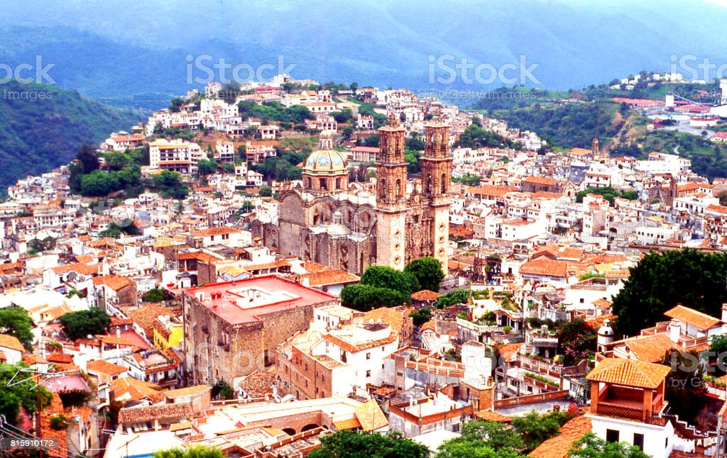 Looking down on the historic central area and cathedral of the colonial town of Taxco Guerrero Mexico stock photo