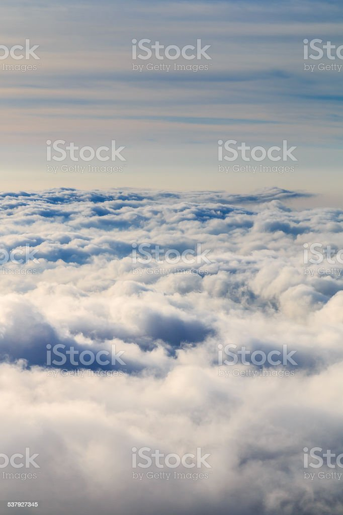 Looking down onto clouds at sunset stock photo