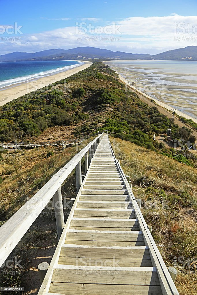 Looking down steps on narrow neck of land stock photo