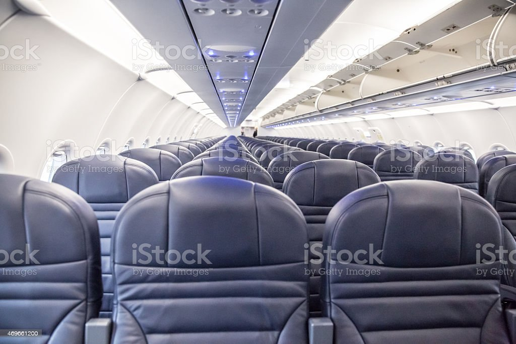 Looking down the aisle a of empty passenger jet. stock photo