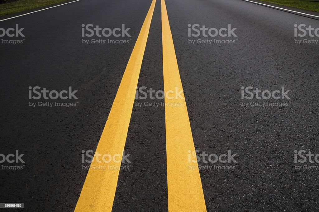 Looking Down the Middle of Dividing Lines on New Road royalty-free stock photo