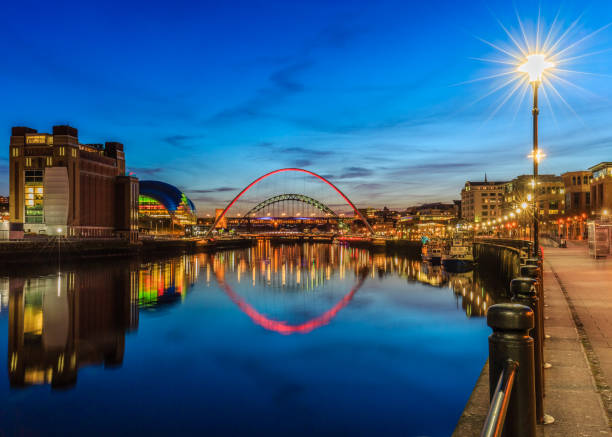 looking down the river tyne towards landmark bridges at sunset - gateshead stock photos and pictures