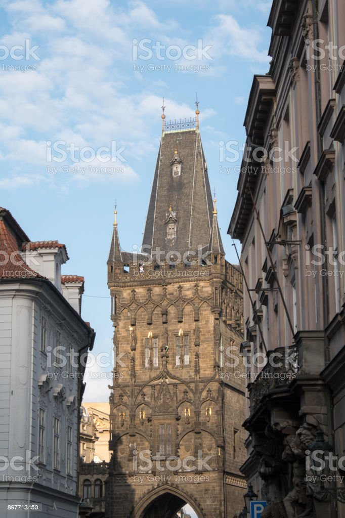 Looking down the street at the facade of the Powder Tower (Prasna brana), medieval gate from the 15th Century in Prague, separating Old Town from New Town, Prague Czech Republic. stock photo