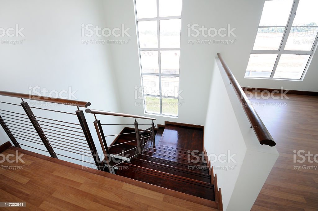 Looking down the wooden staircase in a new home royalty-free stock photo