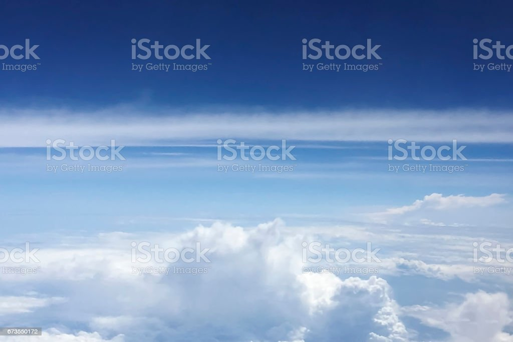 Looking down to the clouds from the aircraft. royalty-free stock photo
