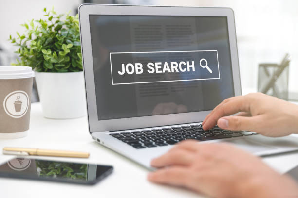 Looking for a job. Job search on laptop screen stock photo