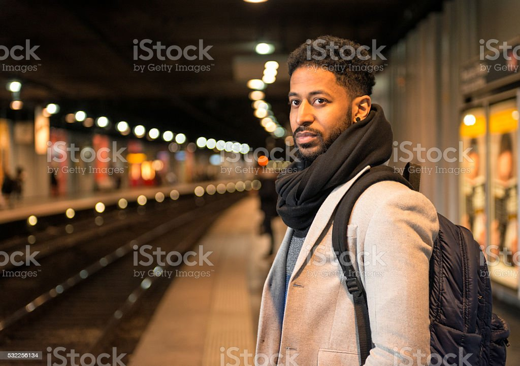 Looking for a subway train on the metro platform stock photo
