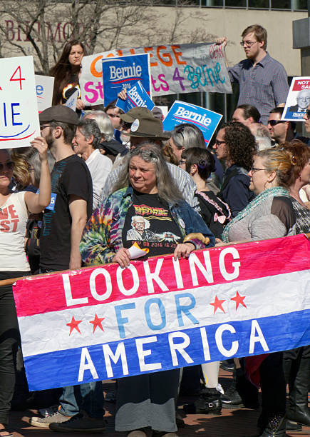 Looking For America At a Bernie Sanders Rally Asheville, North Carolina, USA - February 28, 2016:  Crowd of supporters at a Bernie Sanders rally hold signs and look for America in downtown Asheville, NC bernie sanders stock pictures, royalty-free photos & images