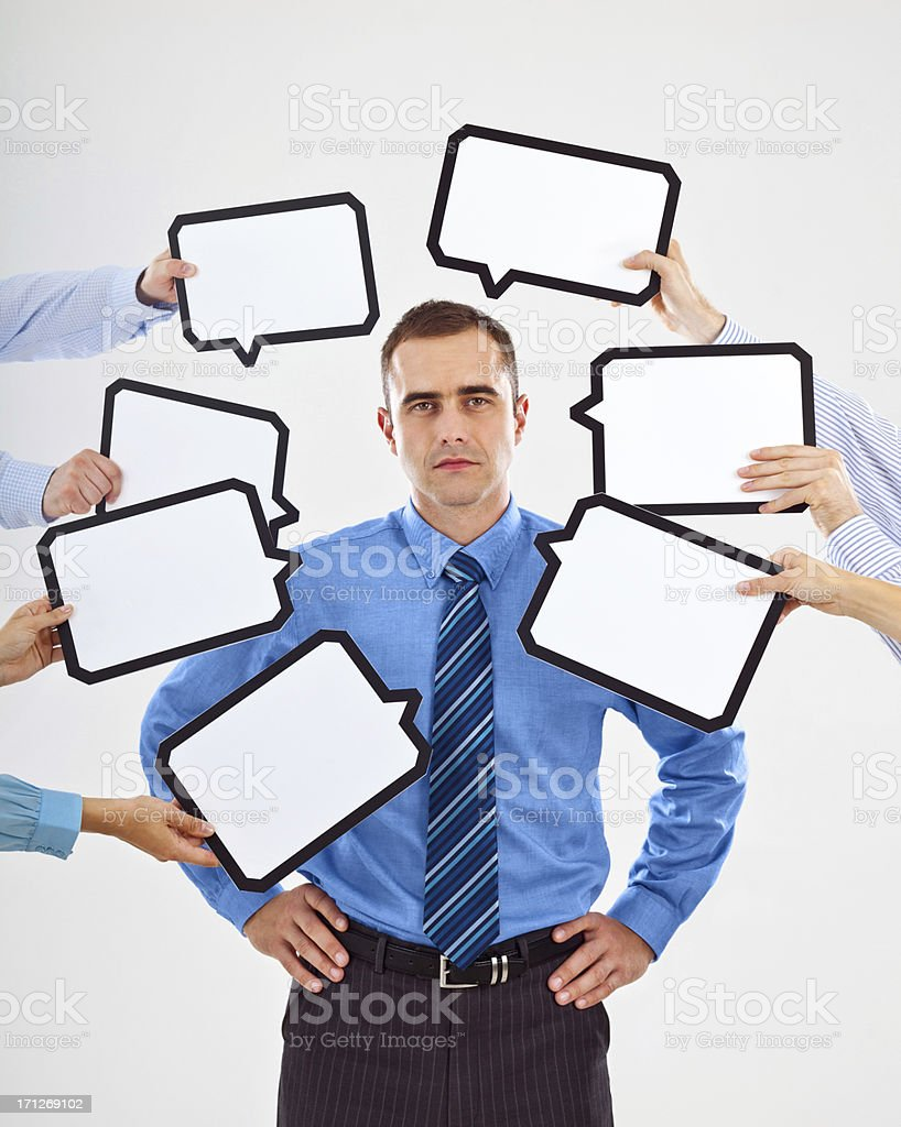 Looking for an idea Portrait of serious businessman surrounded by many speech bubbles with copyspace, looking at camera. 30-34 Years Stock Photo