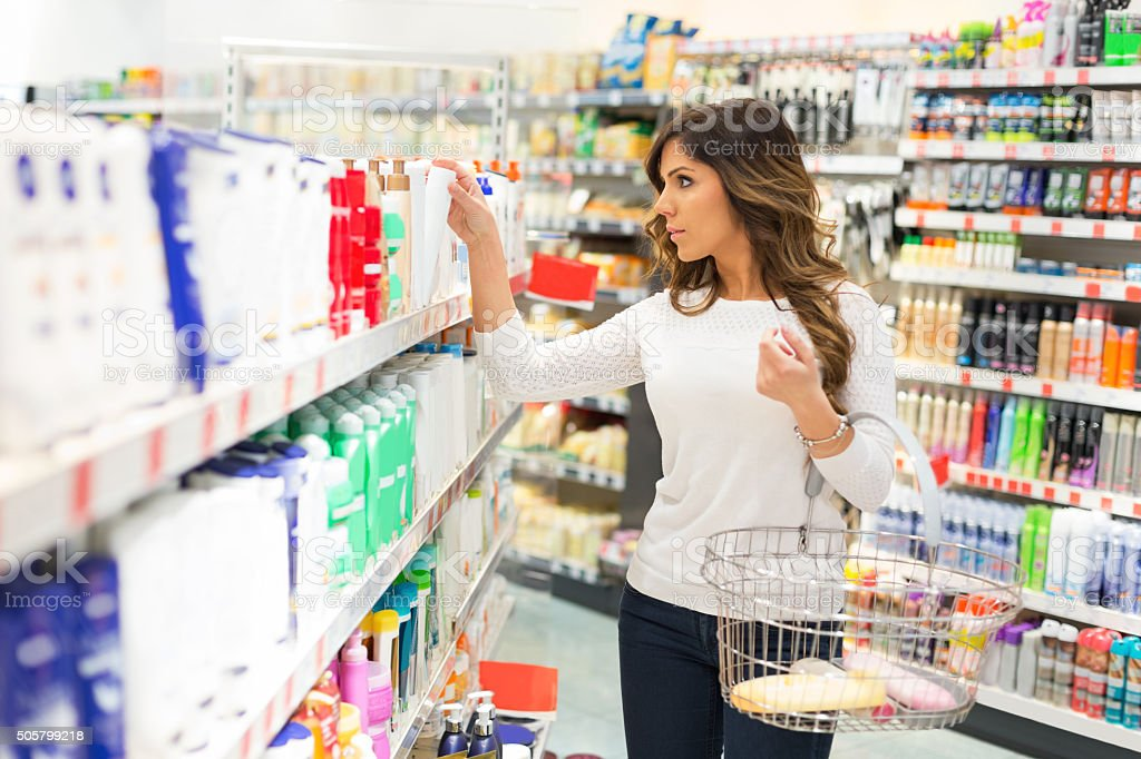 Looking for cosmetics in supermarket stock photo