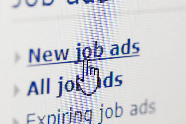 looking for new job on internet ads stock photo