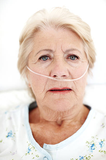 Looking for support and companionship - Senior Health Closeup portrait of a sick elderly woman in hospital looking anxiously at you oxygen tube stock pictures, royalty-free photos & images
