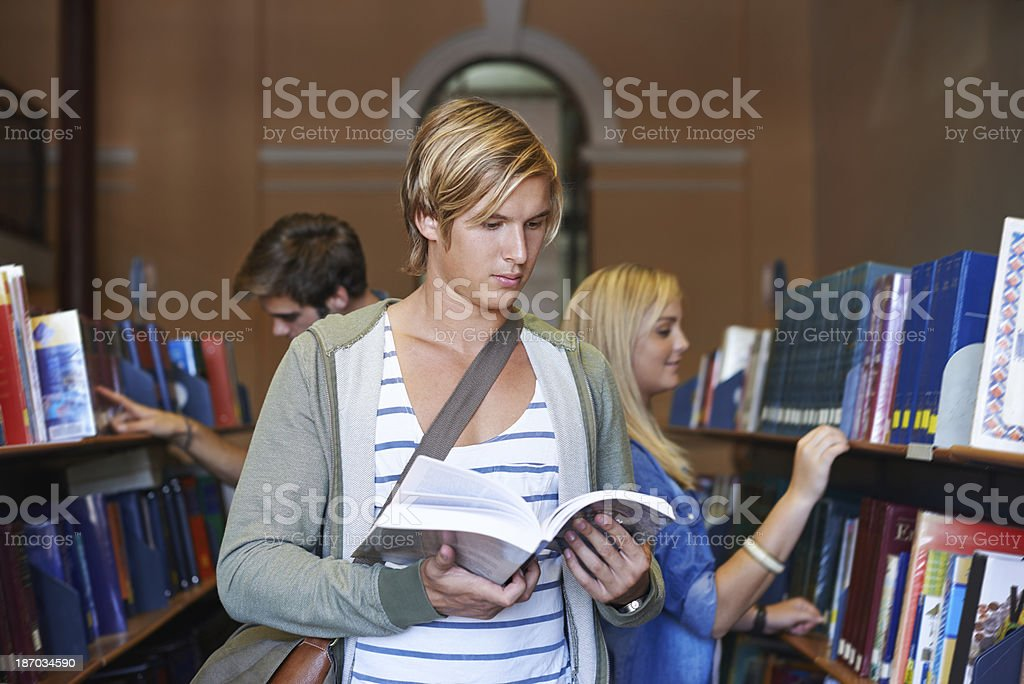 Looking for the correct textbook royalty-free stock photo