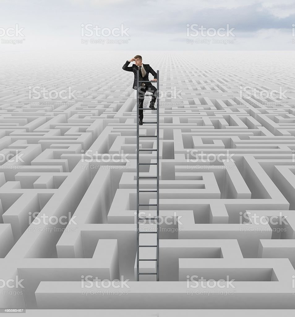 Looking for the solution of the maze stock photo