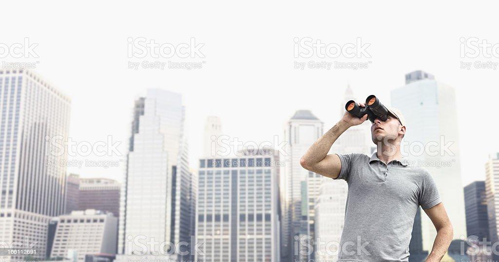Looking forward man with binocular in NYC royalty-free stock photo