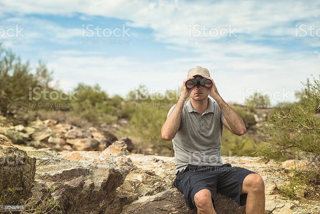Looking forward man with binocular royalty-free stock photo