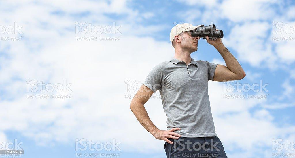 Looking forward man with binocular royalty-free stock photo