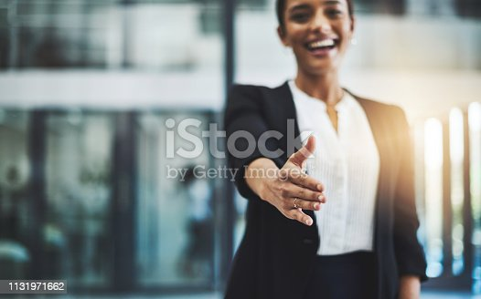 Cropped shot of a young businesswoman extending her arm for a handshake