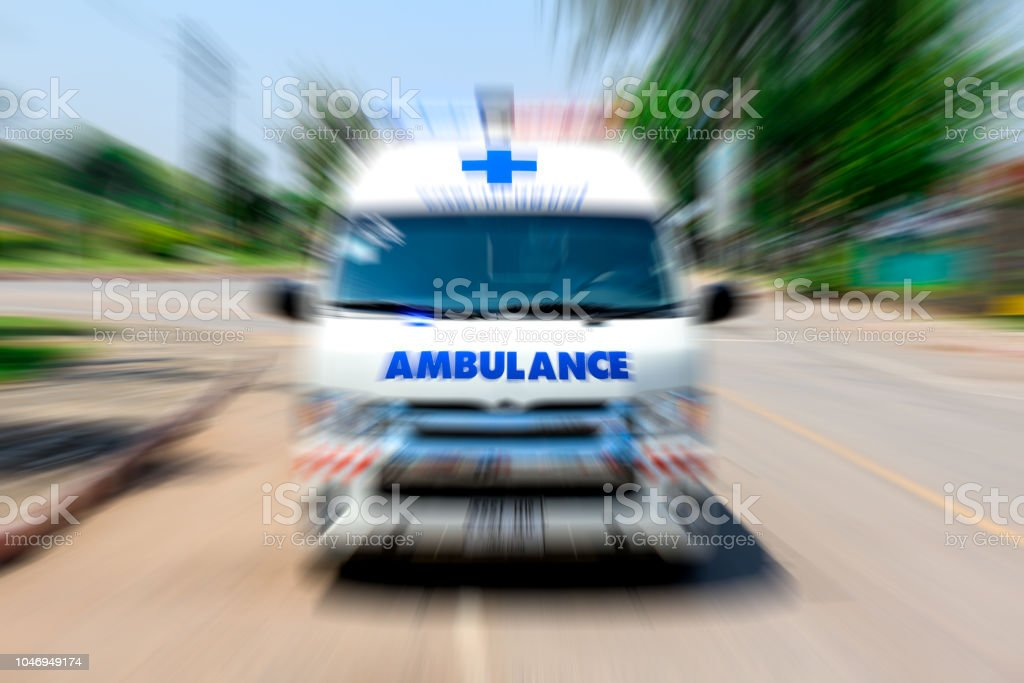 Looking From The Rearview Mirror Ambulance Speeding To