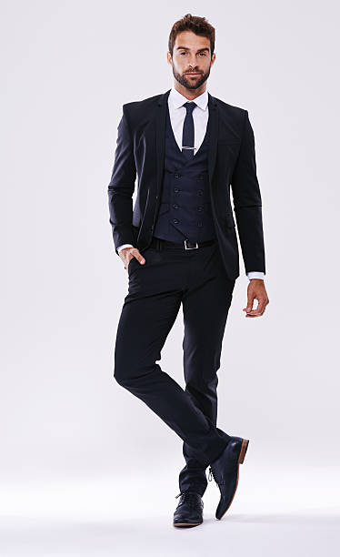 Looking good in a suit Studio shot of a handsome and well-dressed young manhttp://195.154.178.81/DATA/shoots/ic_784174.jpg evening wear stock pictures, royalty-free photos & images
