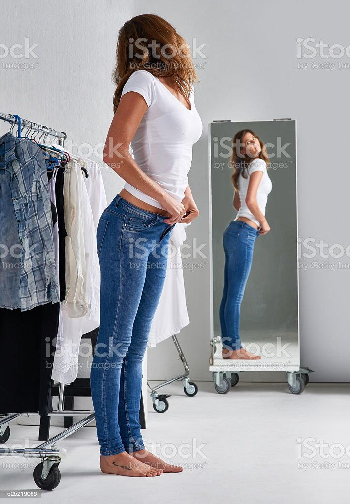 Looking good in her new jeans stock photo