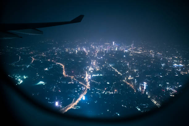 Looking guangzhou night through airplane window stock photo
