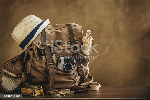 Looking image of travelling concept, essential vacation items. Backpack. Retro effect.