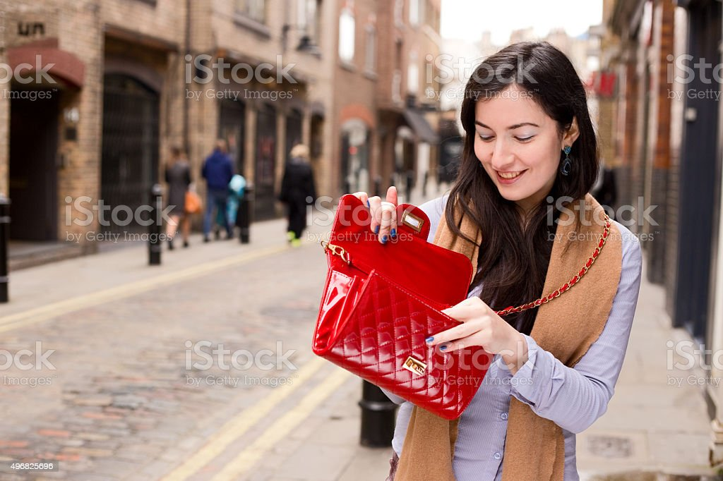 looking in handbag stock photo
