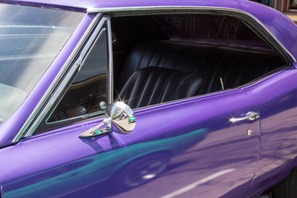 Looking in the driver's side window of a purple muscle car
