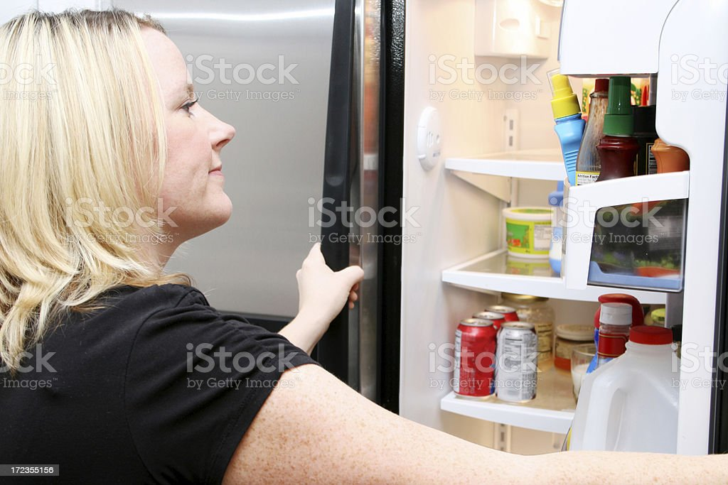 Looking in the Refrigerator royalty-free stock photo