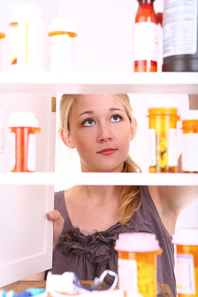 Looking inside Medicine Cabinet stock photo