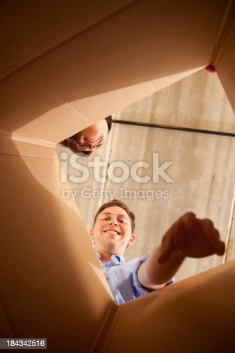 istock Looking into a box 184342516