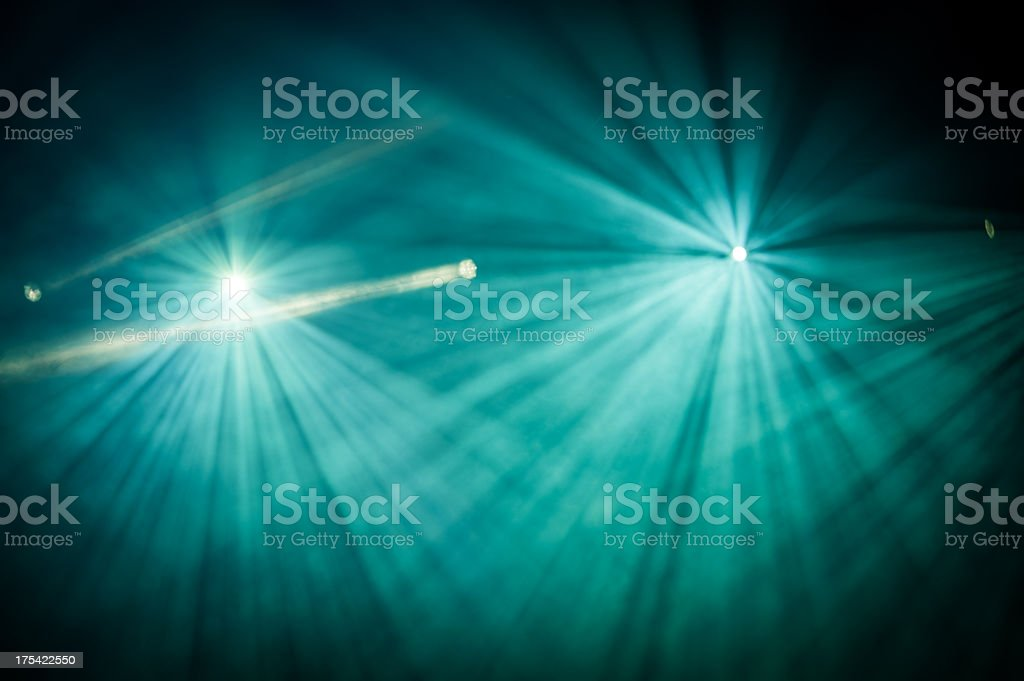 Looking into two full stage lights and spotlight to left stock photo
