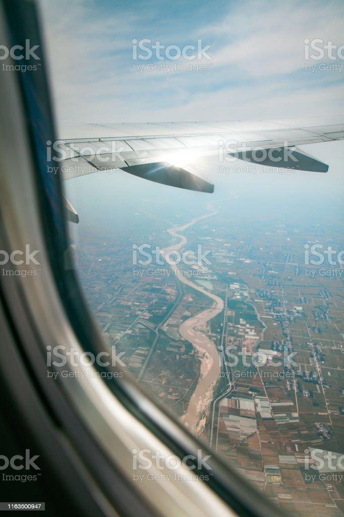 Looking land through airplane window